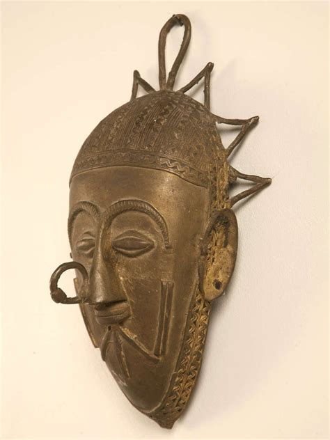 Highly Stylized and Decorative African Bronze Mask at 1stdibs