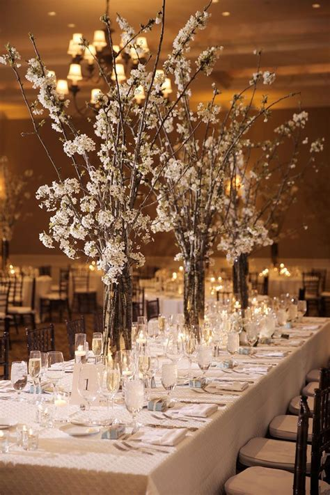 White Cherry Blossom branches as centerpieces for a winter