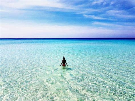 Woman-in-Water-on-Long-Beach-Koh-Rong-Island-in-Cambodia